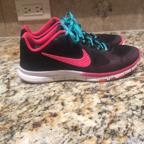 timeless design 8809f 948f1 Pink and Black Nike Free 3.0 athletic shoes